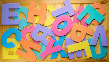 english letters: colorful english letters on brown wooden board
