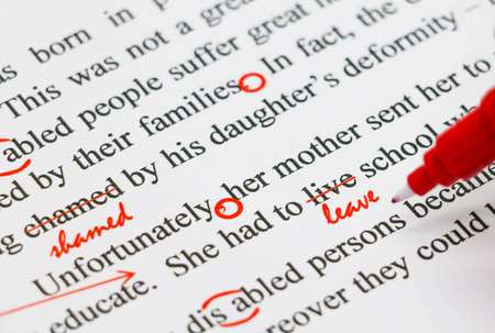 closeup red marks on proofreading english document Stock Photo - 69541321