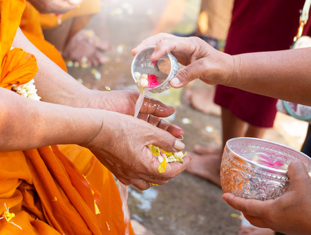 monk hand waiting for water from people represent celebrating thai new year