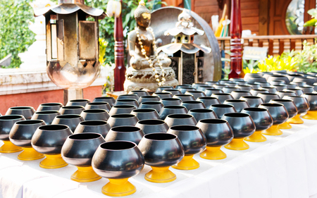 black monks alms bowls on table in temple waiting for donation