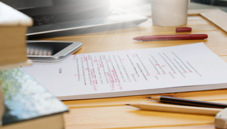 proofreading text on table in office
