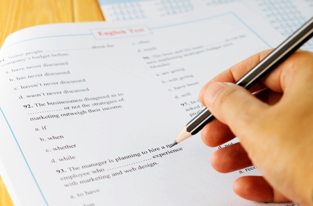 english test on table with pencil
