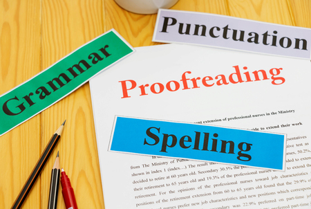 proofreading paper on table with office supplies Stok Fotoğraf - 79872318