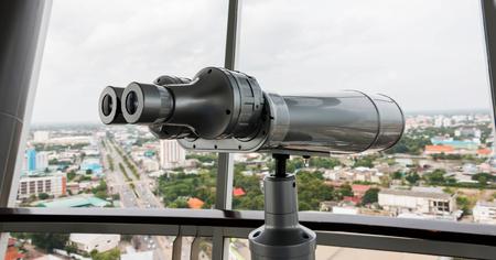 binoculars on top of high tower Stock Photo