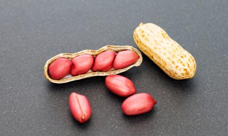 close up fresh red peanuts on black
