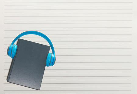 book and headphone over white paper line Stock Photo