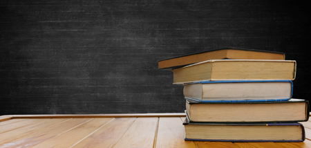 classroom background with textbooks, desk, and chalkboard