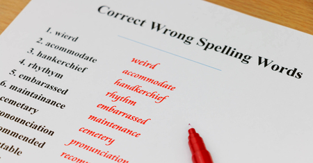 rewrite: English spelling sheet on table