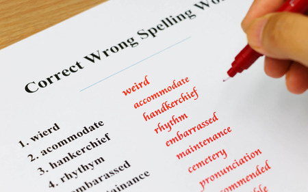 English spelling sheet on table
