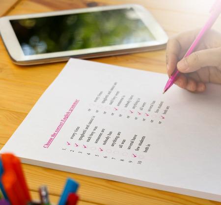 English test sheet on wooden desk