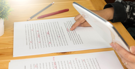 Hand working on paper for proofreading 版權商用圖片