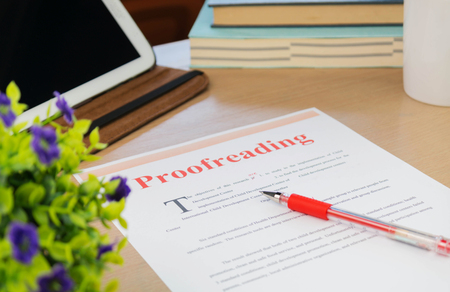 proofreading paper on table in office