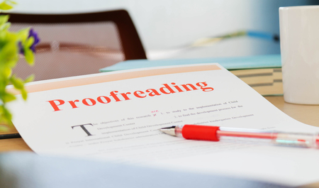 proofreading paper on table in office Stock Photo - 100211149