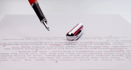 proofreading paper on white table in office Stock Photo