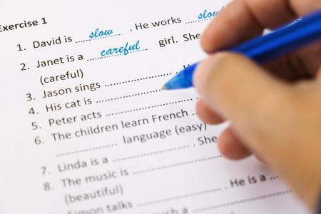 hand holding blue pen taking English test Stock Photo