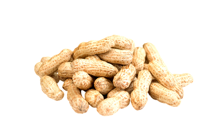 isolated pile of raw peanuts on white background