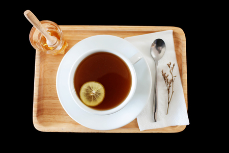 isolated top view hot tea set with honey on black