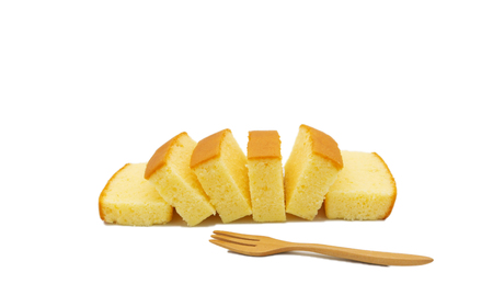 isolated slices of fresh butter cake on white background