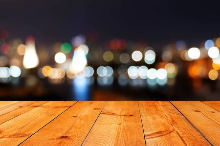 perspective of brown wooden board over blur bokeh background