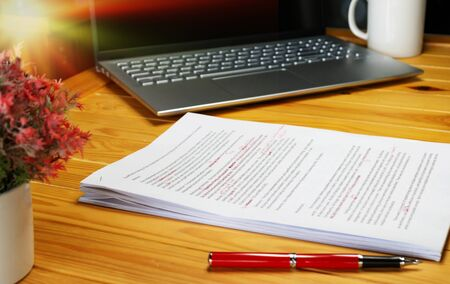 proofreading paper on table in office for service Stok Fotoğraf