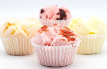fresh colorful homemade cupcake on white background