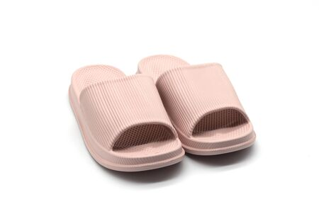 isolated pink rubber slippers on white background