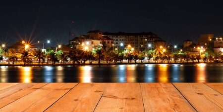 perspective wooden board over cityscape at night