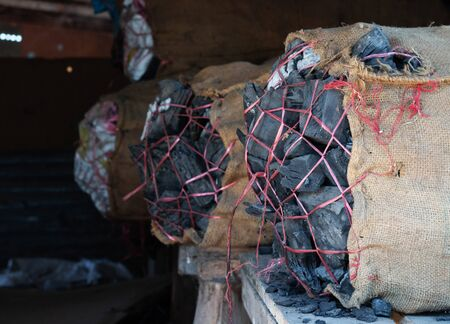 wood carbon in sacks for industry of energy Banco de Imagens