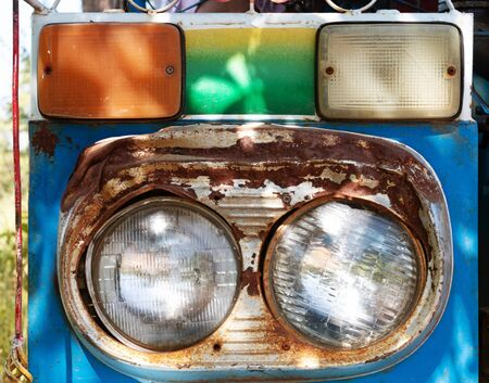 worn out headlight of farmers car in Thailand