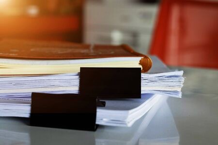 paperwork and book on white table in office Banco de Imagens