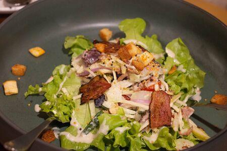 bacon salad on bowl in restaurant for dinner