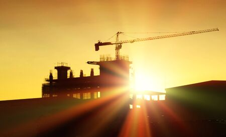 silhouette construction site in sunset with light ray Banco de Imagens