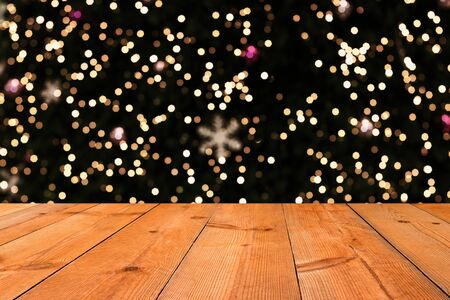 perspective wooden board over blurry bokeh starry lights