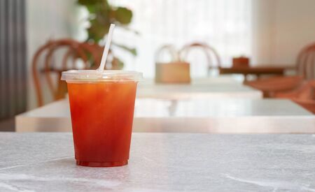 glass of ice tea on cafe table in summer