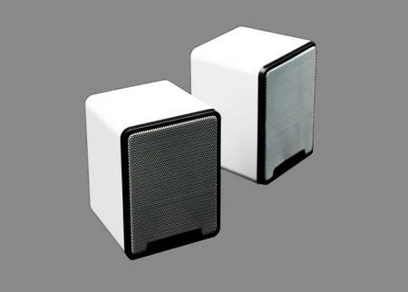 isolated white computer speakers on gray background