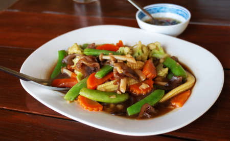 Thai mixed vegetable stir-fried in oyster sauce in white plate