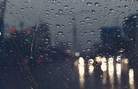 raindrops on windshield at night in bad weather condition Stock Photo