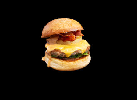isolated fresh bacon cheese burger on black background Stock Photo