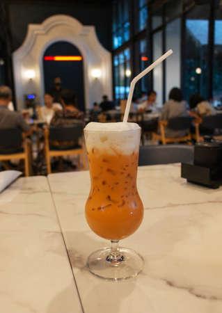 cold Thai tea on table in restaurant for dinner