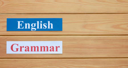 English flashcards on wooden board with copy space