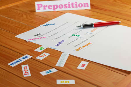 English preposition work sheet on wooden table 스톡 콘텐츠