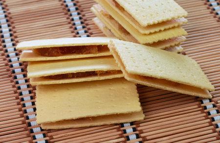 Thai traditional pineapple stuffed crackers on bamboo mat 스톡 콘텐츠