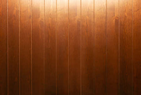brown wooden wall with light on top for background