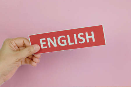 hand holding colorful sign of English learning skills over colorful wall