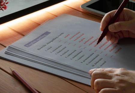 English spelling worksheet on wooden table Reklamní fotografie