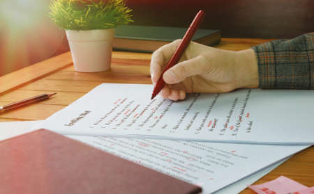English proofreading paper on table in office with office supplies Reklamní fotografie