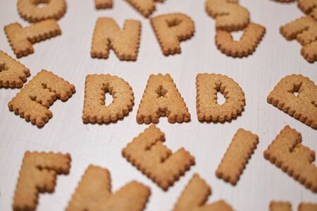 Father word made of gingerbread cookies. cookies alphabet Reklamní fotografie