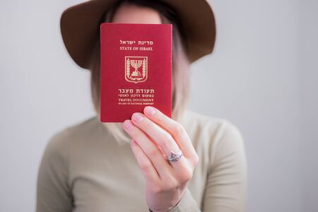 Young woman with Israel passport. Portrait without face. immigration travel concept