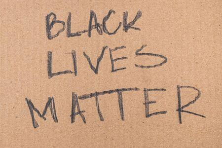 Black lives matter words written on cardboard Stock Photo