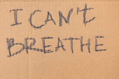 I cantt breathe words written on cardboard closeup